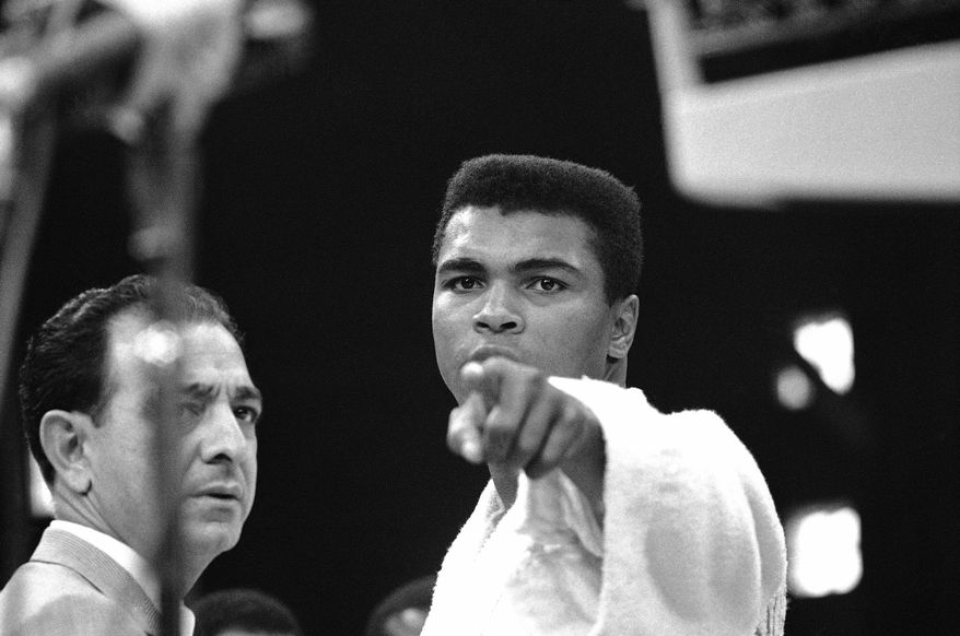 Muhammad Ali found motivation by pointing at an opponent while visualizing him as the thief of a cherished childhood bike. (AP Photo)