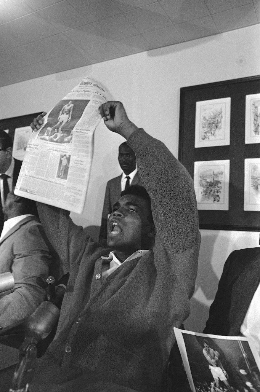 Banner headlines proclaiming his feat occupied the attention of heavyweight champion Muhammad Ali ?Cassius Clay? at his motel at nearby Auburn.   Clay successfully retained crown via a one-round KO over Sonny Liston in Lewiston, Me., on May 26, 1965. (AP Photo)