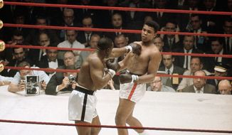 Muhammad Ali (Formerly Cassius Clay) in action against Sonny Liston. Ali was the winner in Miami Beach, Florida on February 25, 1964. (AP Photo)