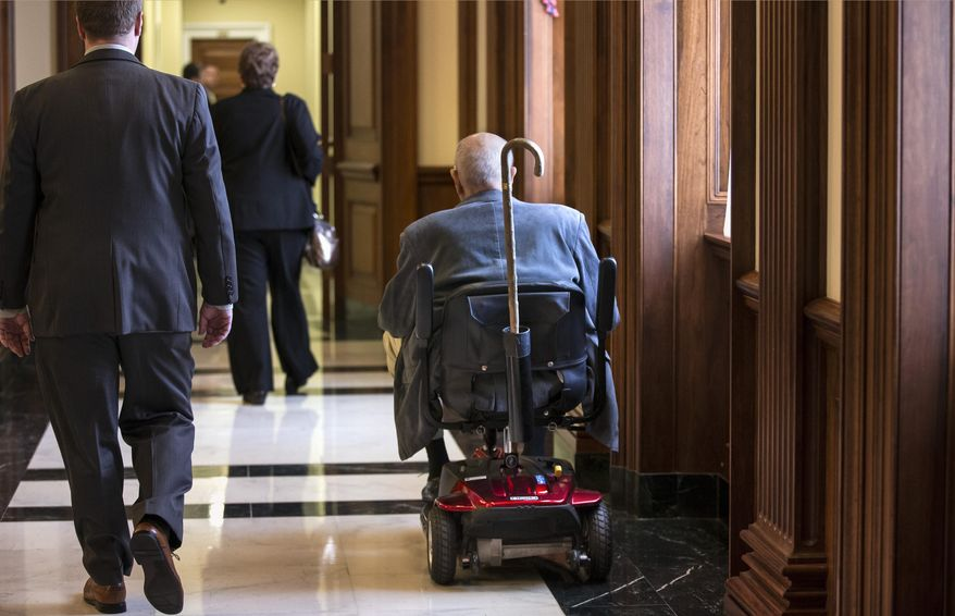 FILE - This Oct. 5, 2013 file photo shows House Democrats, including Rep. John Dingell, D-Mich., center, the longest-serving member of Congress in history, make their way to the office of House Minority Leader Nancy Pelosi before a vote as Congress, on Capitol Hill in Washington. Dingell, the longest-serving member of Congress, plans to retire. (AP Photo/J. Scott Applewhite, File)