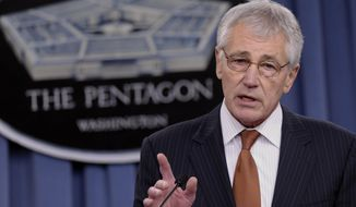 ** FILE **  In this Feb. 7, 2014 file photo, Defense Secretary Chuck Hagel speaks during a briefing at the Pentagon. A U.S. official says that as part of the proposed 2015 defense budget, Pentagon chief Chuck Hagel is recommending shrinking the Army to its smallest size in decades.  (AP Photo/Susan Walsh)