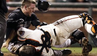 FILE - In this May 25, 2011 file photo, Florida Marlins' Scott Cousins, top, collides with San Francisco Giants catcher Buster Posey (28) on a fly ball from Emilio Bonifacio during the 12th inning of a baseball game in San Francisco. Cousins was safe for the go ahead run. A new rule, 7.13, was adopted by MLB and the players' association on a one-year experimental basis, the sides said Monday, Feb. 24, 2014. The umpire crew chief can use the new video-review system to determine whether the rule was violated. (AP Photo/Marcio Jose Sanchez, File)