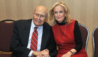 U.S. Rep. John Dingell, left, and his wife Debbie hold hands during a legislative forum at the Southern Wayne County Regional Chamber (SWCRC) at the Crystal Gardens in Southgate, Mich. on Monday, Feb. 24, 2014. John Dingell, the longest-serving member of Congress in American history and a champion of Detroit's auto industry, has announced his retirement. (AP Photo/Detroit News, Max Ortiz)  DETROIT FREE PRESS OUT; HUFFINGTON POST OUT