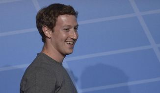 Mark Zuckerberg Chairman and CEO of Facebook smiles during a conference at the Mobile World Congress, the world's largest mobile phone trade show in Barcelona, Spain, Monday, Feb. 24, 2014. Expected highlights include major product launches from Samsung and other phone makers, along with a keynote address by Facebook founder and chief executive Mark Zuckerberg. (AP Photo/Manu Fernandez)