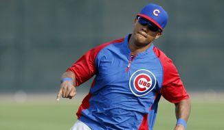 Chicago Cubs shortstop Starlin Castro (13) runs the bases during spring training baseball practice, Friday, Feb. 21, 2014, in Mesa, Ariz. (AP Photo/Rick Scuteri)