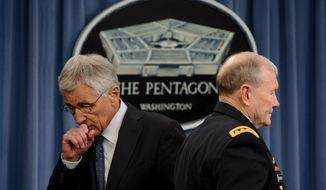 Secretary of Defense Chuck Hagel, left, and Chairman of the Joint Chiefs of Staff Gen. Martin E. Dempsey, right, speak at a press conference at the Pentagon, Arlington, Va., Monday, February 24, 2014. (Andrew Harnik/The Washington Times)