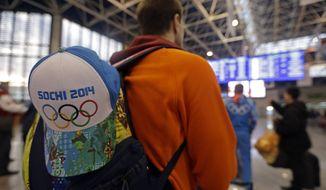 A passenger checks the status of flights at the Sochi Airport following the 2014 Winter Olympics, Monday, Feb. 24, 2014, in Sochi, Russia. (AP Photo/Darron Cummings)