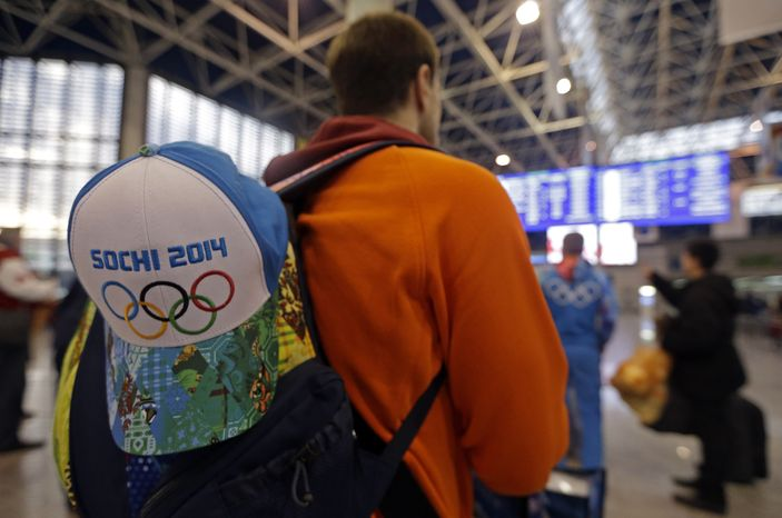A passenger checks the status of flights at the Sochi Airport following the 2014 Winter Olympics, Monday, Feb. 24, 2014, in Sochi, Russia. (AP Photo/Darron Cummings)