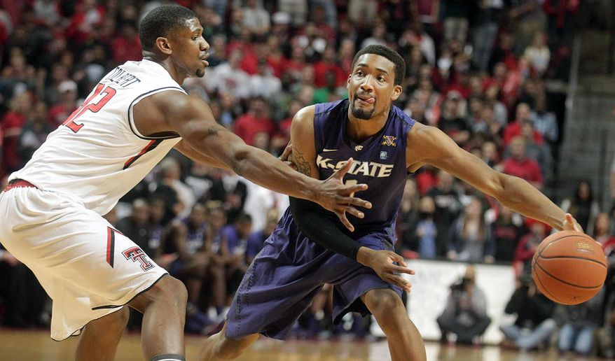Kansas State's  Shane Southwell (1) looks to pass around Texas Tech's Jordan Tolbert during an NCAA college basketball game in Lubbock, Texas, Tuesday, Feb, 25, 2014. (AP Photo/Lubbock Avalanche-Journal, Stephen Spillman) ALL LOCAL TV OUT