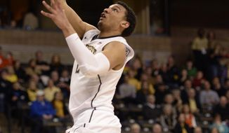 Wake Forest University forward Devin Thomas (2) goes for two during the first half of an NCAA college basketball game against Clemson University at Joel Coliseum in Winston-Salem, N.C., Tuesday, Feb. 25, 2014. (AP Photo/The Journal, Bruce Chapman)