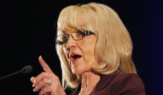Gov. Jan Brewer, Arizona Republican, finds herself in the middle of a national battle over a religious freedom bill sitting on her desk that would allow business owners to refuse service based on their religious beliefs. (Associated Press)