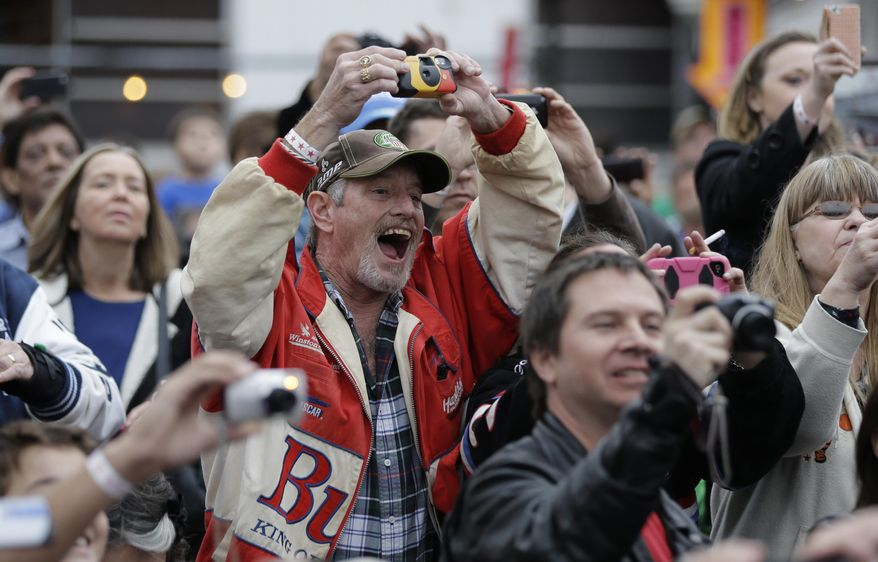 Fans cheer as Daytona 500 winner Dale Earnhardt Jr. arrives for a victory tour stop, Tuesday, Feb. 25, 2014, in Austin, Texas. Earnhardt won his second Daytona 500 Sunday. (AP Photo/Eric Gay)