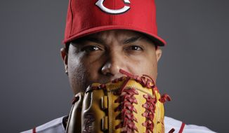Cincinnati Reds pitcher Alfredo Simon poses during the team photo day before spring training baseball workouts Thursday, Feb. 20, 2014, in Goodyear, Ariz. (AP Photo/ Gregory Bull)