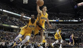 Indiana Pacers guard Lance Stephenson (1) and forward Luis Scola (4) go after a loose ball while playing the Los Angeles Lakers during the first half of an NBA basketball game in Indianapolis, Tuesday, Feb. 25, 2014. (AP Photo/AJ Mast)