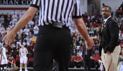 Missouri Tigers head coach Frank Haith looks to a referee for a call during the first half of an NCAA college basketball game Tuesday, Feb. 25, 2014, in Athens, Ga. (AP Photo/The Banner-Herald, Richard Hamm) MAGS OUT; MANDATORY CREDIT