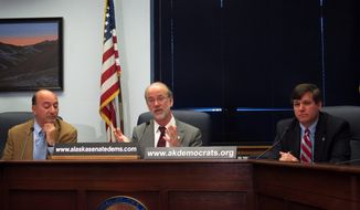 Minority Democrats outlined their proposal for changes to Alaska's oil tax structure should a referendum on the current system be approved later this year, on Monday, Feb. 24, 2014, in Juneau, Alaska. Pictured are, from left, Rep. Les Gara and Sens. Hollis French and Bill Wielechowski. All three are from Anchorage. (AP Photo/Becky Bohrer)
