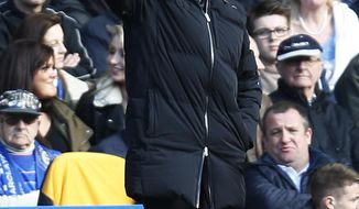 Chelsea's manager Jose Mourinho gives instructions to his players during an English Premier League soccer match against Everton at the Stamford Bridge ground in London, Saturday, Feb. 22, 2014. Chelsea won the match 1-0. (AP Photo/Lefteris Pitarakis)