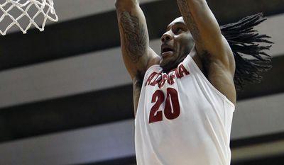 Alabama's Levi Randolph (20) dunks in the first half of an NCAA college basketball game against Missouri, Saturday, Feb. 22, 2014, in Tuscaloosa, Ala. (AP Photo/The Tuscaloosa News, Dusty Compton)
