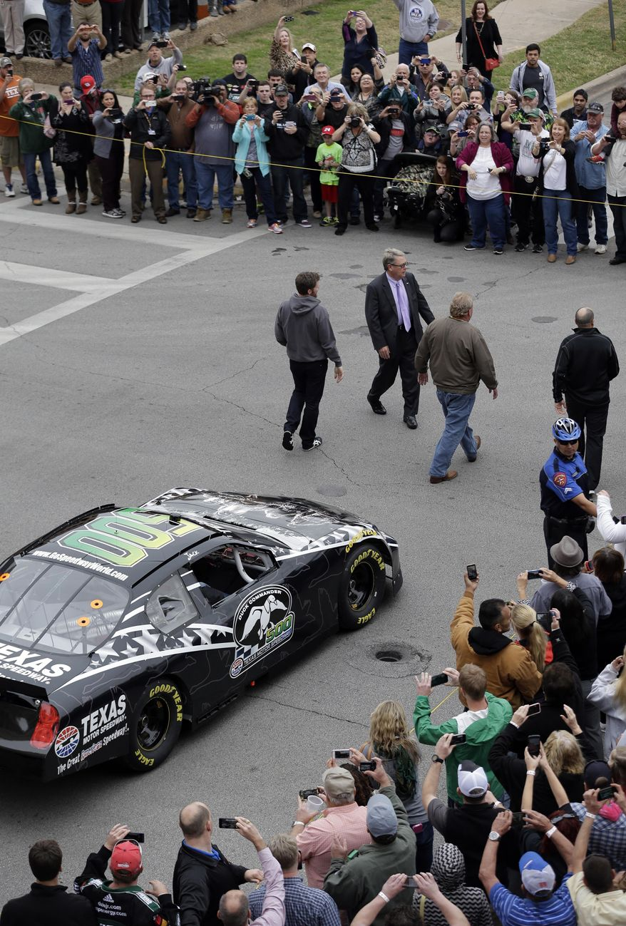Daytona 500 winner Dale Earnhardt Jr., center, arrives for a victory tour stop, Tuesday, Feb. 25, 2014, in Austin, Texas. Earnhardt won his second Daytona 500 Sunday. (AP Photo/Eric Gay)