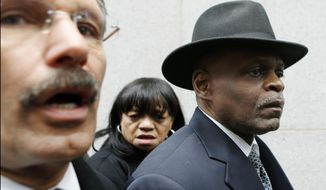 Former Pittsburgh police chief Nathan Harper, right, who pleaded guilty to stealing police funds by depositing them into unauthorized credit union accounts, leaves federal court in Pittsburgh with his wife, Cynthia Harper, center, and his attorney Robert Del Greco, left, after being sentenced to 18 months in prison on Tuesday, Feb. 25, 2014. Harper, 61, also was ordered to repay $31,986 that he took from the fund for himself, including meals and drink tabs at various restaurants and bars. (AP Photo/Keith Srakocic)