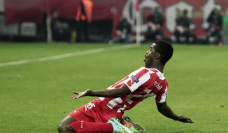 Olympiakos' Joel Campbell celebrates after scoring the second goal of his team against Manchester United during their Champions League, round of 16, first leg soccer match at Georgios Karaiskakis stadium, in Piraeus port, near Athens, on Tuesday, Feb. 25, 2014. (AP Photo/Thanassis Stavrakis)
