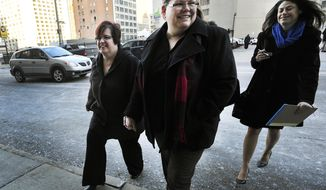 From left, April DeBoer and Jayne Rowse with DeBoer's attorney Dana Nessel enter Federal Court in Detroit, Tuesday, Feb. 25, 2014 before a trial that could overturn Michigan's ban on gay marriage. Gay couples poised for a favorable ruling last fall had lined up for licenses at county offices across Michigan, only to be stunned when U.S. District Judge Bernard Friedman said he wanted to hear testimony from experts.  The case began in 2012 when nurses Rowse, 49, and DeBoer, 42, of Hazel Park sued to try to upset a Michigan law that bars them from adopting each other's children. But the case became even more significant when Friedman invited them to add the same-sex marriage ban to their lawsuit. They argue that Michigan's constitutional amendment, approved by voters in 2004, violates the U.S. Constitution's Equal Protection Clause, which forbids states from treating people differently under the law.  (AP Photo/Detroit News, Daniel Mears)  DETROIT FREE PRESS OUT; HUFFINGTON POST OUT