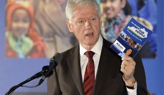 Former President Bill Clinton speaks to a group of supporters during a fundraiser for Democratic Senate challenger Alison Lundergan Grimes, Tuesday, Feb. 25, 2014, in Louisville, Ky. (AP Photo/Timothy D. Easley)