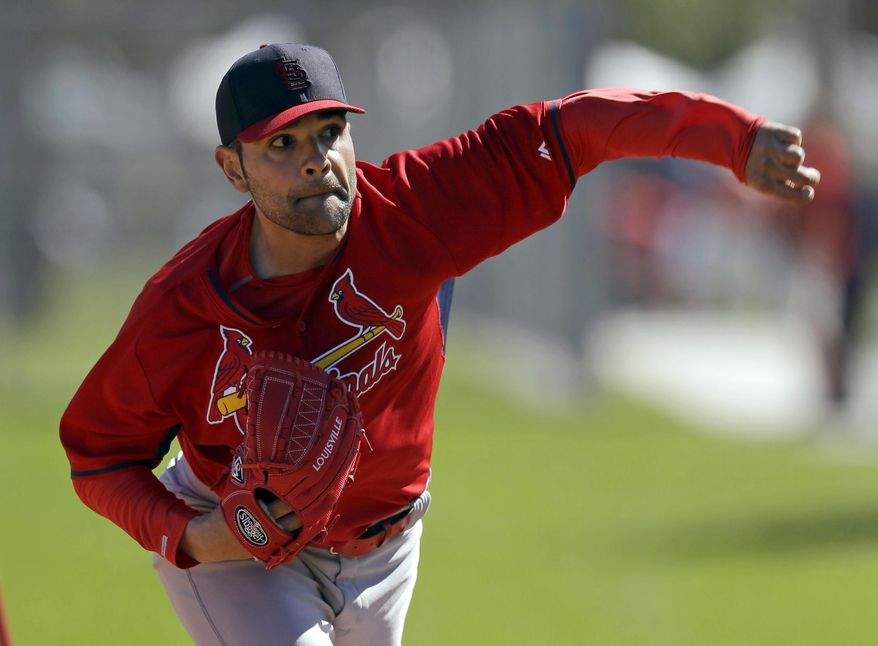 FILE - In this Feb. 16, 2014 file photo, St. Louis Cardinals pitcher Jaime Garcia throws a bullpen session during spring training baseball practice in Jupiter, Fla. The Cardinals have announced Garcia will return to St. Louis on Sunday to have doctors examine his surgically repaired throwing shoulder, making it unlikely he'll be ready for the start of the season. (AP Photo/Jeff Roberson, File)