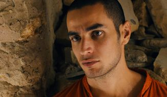 """This film image released by Adopt Films shows Adam Bakri in a scene from the film """"Omar."""" The film was nominated for an Academy Award for best foreign picture on Thursday, Jan. 16, 2014. The 86th Academy Awards will be held on March 2. (AP Photo/Adopt Films)"""