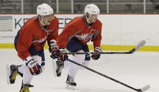 Washington Capitals captain Alex Ovechkin, left, and center Nicklas Backstrom do sprints during a Capitals hockey practice, Tuesday, Feb. 25, 2014, in Arlington, Va. (AP Photo/Carolyn Kaster)