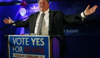 Revere, Mass. Mayor Dan Rizzo speaks to cheering supporters at Suffolk Downs in Revere on Tuesday, Feb. 25, 2014, as they celebrate the passage of a referendum allowing the Mohegan Sun to move forward with its $1.3 billion proposal in Revere and compete with Wynn Resorts for the sole eastern Massachusetts resort casino. (AP Photo/Elise Amendola)