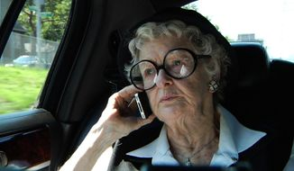 """FILE - This film image released by the Sundance Selects shows Elaine Stritch in a scene from """"Elaine Stritch: Shoot Me."""" At 89, Stritch, as funny and irascible as ever, returned to New York to celebrate the opening of """"Elaine Stritch: Shoot Me,"""" delighting Broadway fans who have missed her. The documentary film premiered in New York City, Friday, Feb. 21, 2014, and releases nationwide. (AP Photo/Sundance Selects, file)"""