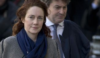 Rebekah Brooks former News International chief executive and her husband Charlie Brooks, arrive at the Central Criminal Court in London where they appear to face charges related to phone hacking, Friday, Feb. 21, 2014. (AP Photo/Alastair Grant)