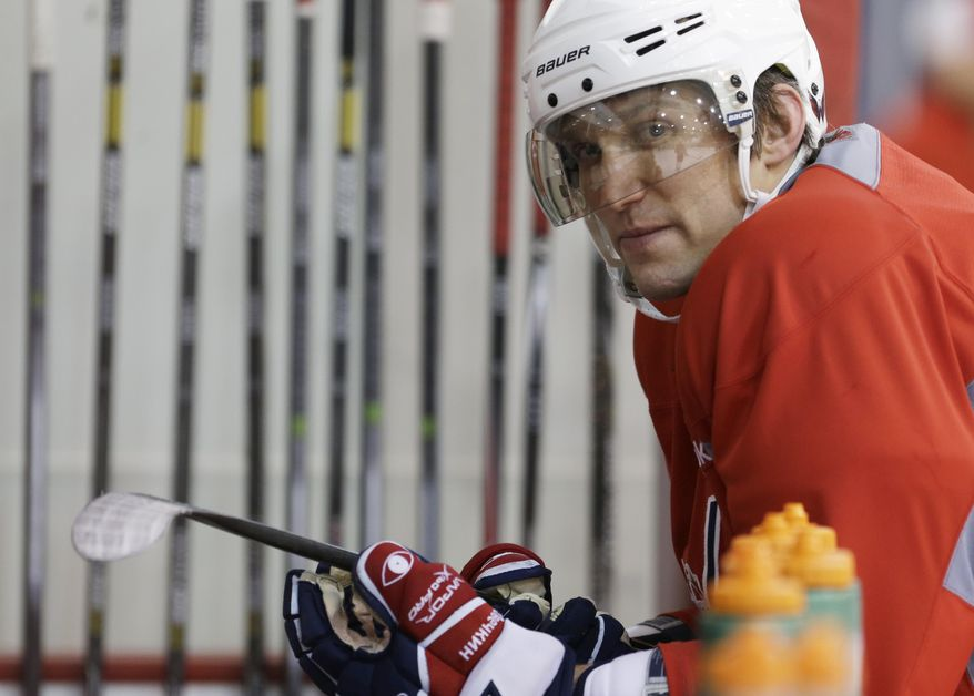 Washington Capitals captain Alex Ovechkin looks from the bench during a Capitols hockey practice, Tuesday, Feb. 25, 2014, in Arlington, Va. (AP Photo/Carolyn Kaster)
