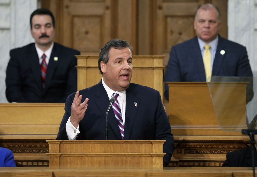 "As the Senate President Stephen M. Sweeney, D-West Deptford, N.J., and Assembly Speaker Vincent Prieto, D-Secaucus, N.J., listen, New Jersey Gov. Chris Christie emphasizes a point as he delivers his budget address at the Statehouse Tuesday, Feb. 25, 2014, in Trenton, N.J. Christie criticized what he calls the ""exploding"" costs of public employee pensions and health care in his fifth annual budget message Tuesday. Christie says the pension reforms enacted during his first term don't go far enough. (AP Photo/Mel Evans)"