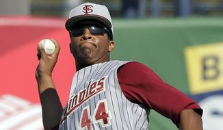 Florida State left fielder Jameis Winston picks up a sixth inning single by New York Yankees' Corban Joseph during a spring training exhibition game against the New York Yankees Tuesday, Feb. 25, 2014, in Tampa, Fla. Winston is the 2013 Heisman Trophy winner. (AP Photo/Chris O'Meara)
