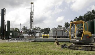 FILE - This Aug. 13, 2013 file photo shows a gas drilling rig at the Detweiler well in Salesville, Ohio. Supreme Court justices in Ohio vigorously challenged attorneys on Wednesday, Feb. 26, 2014 over the power of state-level oil and gas drilling regulations to supersede local zoning laws. (AP Photo/Jay LaPrete, File)