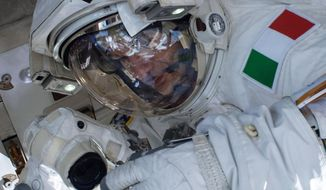 In this Tuesday, July 16, 2013 image provided by NASA, European Space Agency astronaut Luca Parmitano participates in a spacewalk outside the International Space Station. A final report issued Wedesday, Feb. 26, 2014 by NASA says it could have prevented the near-drowning of the spacewalking astronaut on July 16, 2013. According to the report, Parmitano's helmet had also leaked one week earlier at the end of his first spacewalk. The report says the space station team misdiagnosed the first failure and should have delayed the second spacewalk until the problem was understood. (AP Photo/NASA)