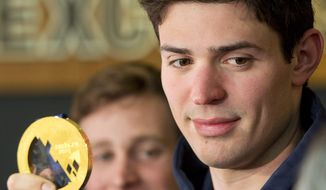 Montreal Canadiens and Team Canada goaltender Carey Price shows his gold medal to the media Monday, Feb. 24, 2014, in Brossard, Quebec. (AP Photo/The Canadian Press, Ryan Remiorz)