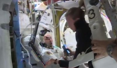 In this Tuesday, July 16, 2013 image from video made available by NASA, astronaut Karen Nyberg assists astronaut Luca Parmitano remove his space suit after an aborted spacewalk aboard the International Space Station. A final report issued Wedesday, Feb. 26, 2014 by NASA says it could have prevented the near-drowning of the spacewalking astronaut. According to the report, Parmitano's helmet had also leaked one week earlier at the end of his first spacewalk. The report says the space station team misdiagnosed the first failure and should have delayed the second spacewalk until the problem was understood. (AP Photo/NASA)