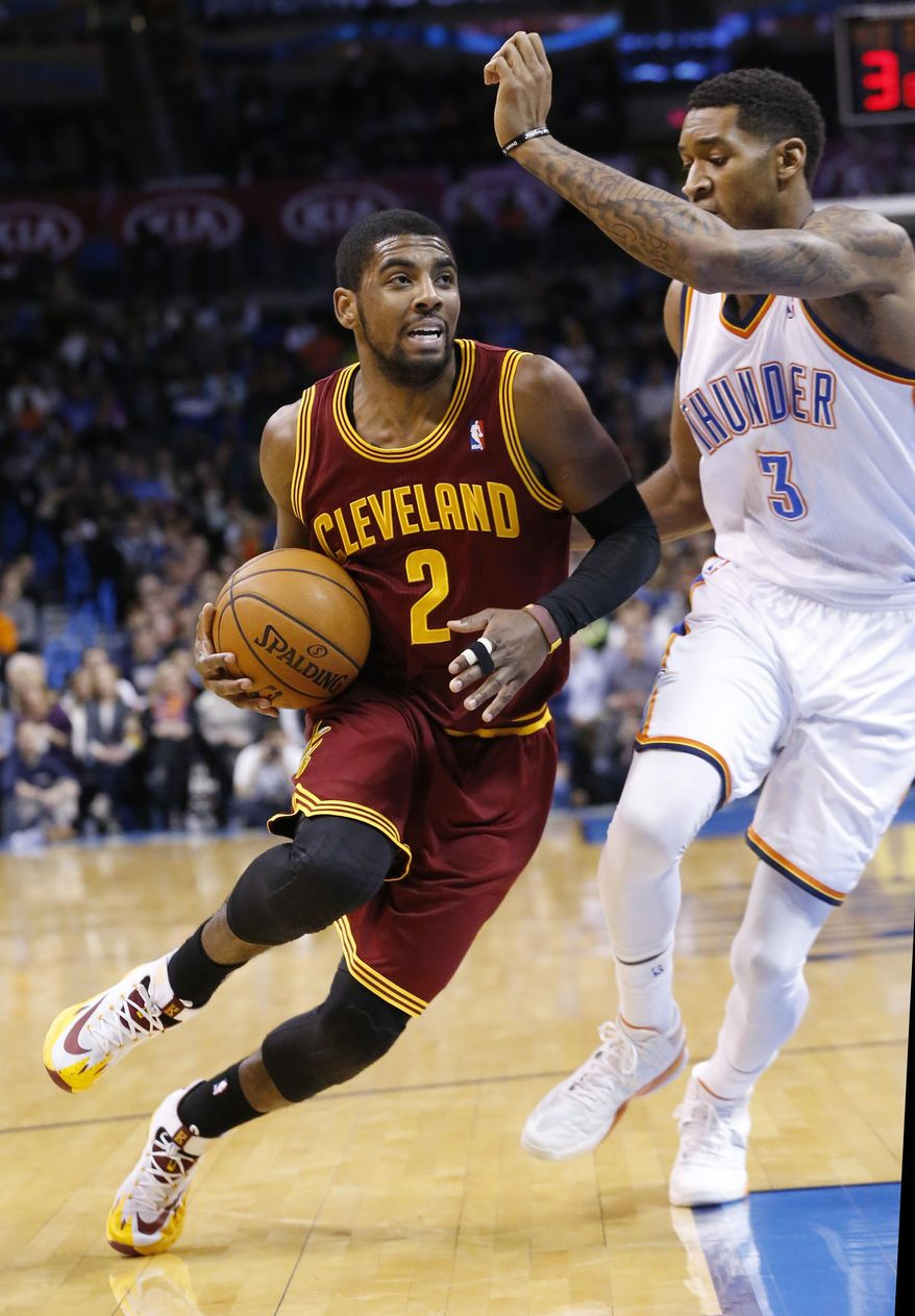 Cleveland Cavaliers guard Kyrie Irving (2) drives past Oklahoma City Thunder forward Perry Jones (3) during the first quarter of an NBA basketball game in Oklahoma City, Wednesday, Feb. 26, 2014. (AP Photo/Sue Ogrocki)