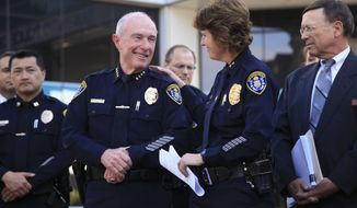 Assistant Police Chief Shelley Zimmerman, second from right, and retiring Police Chief William Lansdowne at San Diego Police Department headquarters, Wednesday, Feb. 26, 2014, during an announcment that Zimmerman would be the department's new top officer. (AP Photo/U-T San Diego, David Brooks) NO SALES; COMMERCIAL INTERNET OUT MANDATORY CREDIT.