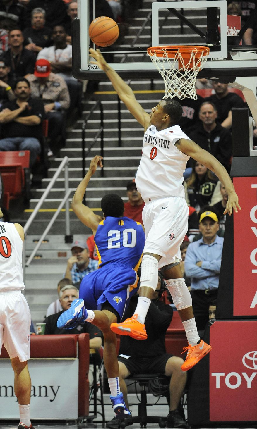 San Diego State's Skylar Spencer (0) blocks a shot by San Jose State's Issac Thornton (20) during the first half of an NCAA college basketball game on Tuesday, Feb. 25, 2014, in San Diego. (AP Photo/Denis Poroy)