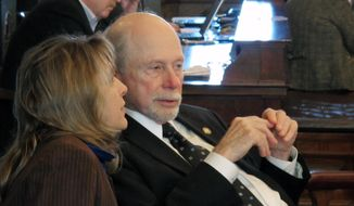Kansas state Sens. Elaine Bowers, left, a Concordia Republican, and Les Donovan, right, a Wichita Republican, confer during a debate over legislation raising the state's cap on non-economic damages in personal injury lawsuits, Wednesday, Feb. 26, 2014, at the Statehouse in Topeka, Kan. The measure has the support of the Kansas Chamber of Commerce because of other provision changing evidence rules. (AP Photo/John Hanna)