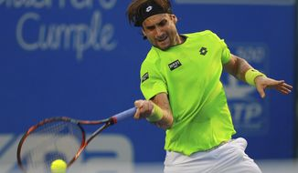 Spain's David Ferrer returns the ball to Spain's Feliciano Lopez at the Mexican Tennis Open in Acapulco, Mexico, Wednesday Feb. 26, 2014. (AP Photo/Jam Media, Hugo Avila)