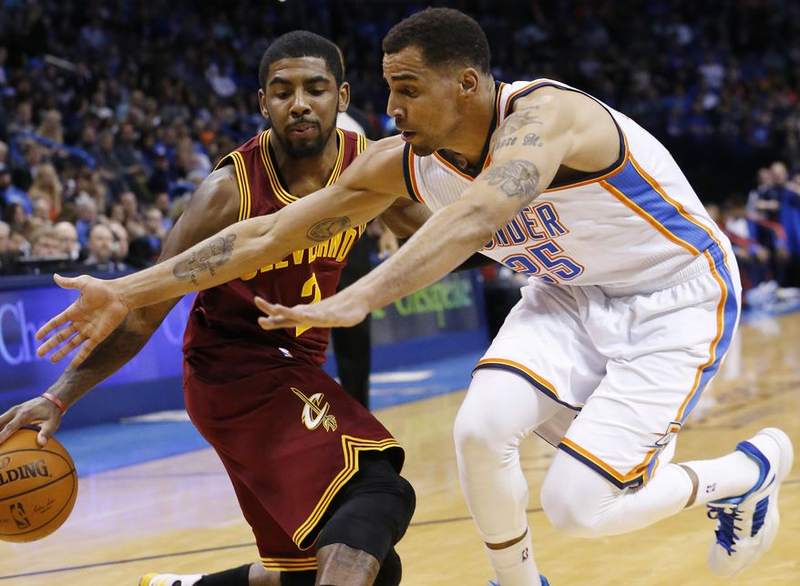 Cleveland Cavaliers guard Kyrie Irving (2) drives as Oklahoma City Thunder guard Thabo Sefolosha (25) reaches for the ball during the first quarter of an NBA basketball game in Oklahoma City, Wednesday, Feb. 26, 2014. (AP Photo/Sue Ogrocki)