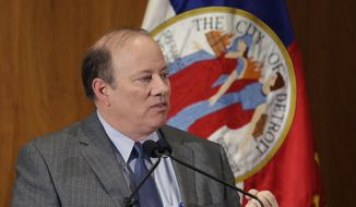 Detroit Mayor Mike Duggan delivers his first State of the City address, Wednesday, Feb. 26, 2014, in Detroit. (AP Photo/Carlos Osorio)