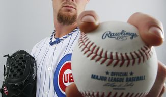 Chicago Cubs pitcher Travis Wood poses for a photo Monday, Feb. 24, 2014, in Mesa, Ariz. Wood was the team's best starting pitcher in a 2013 season in which he went 9-12 (on a 66-win team) with an ERA of 3.11, a WHIP of 1.145 and an even 200 innings pitched. All of which added up to an All-Star appearance. (AP Photo/Ross D. Franklin)