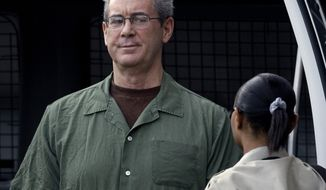 FILE - In this Aug. 24, 2010 file photo, R. Allen Stanford arrives in custody at the federal courthouse for a hearing in Houston. The Supreme Court ruled Wednesday that class-action lawsuits from investors who lost billions in former Texas tycoon R. Allen Stanford's massive Ponzi scheme can go forward. The decision is a loss for individuals, law firms and investment companies that allegedly aided Stanford's fraud and wanted the lawsuits thrown out. (AP Photo/David J. Phillip, File)