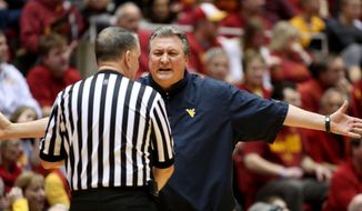 West Virginia coach Bob Huggins argues with an official, shortly before being assessed a technical foul during the first half of an NCAA college basketball game against Iowa State in Ames, Iowa, Wednesday, Feb. 26, 2014. (AP Photo/Justin Hayworth)